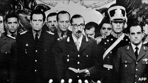 General Jorge Rafael Videla (C) before he was sworn in as Argentina's President, on 30 March after a military coup 24 March 1976