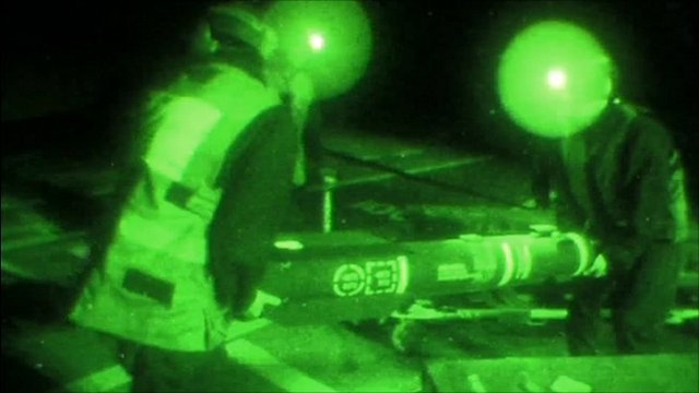 Loading missiles onto Apaches