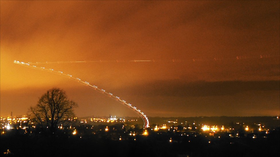 A night helicopter flight is captured by a 30 second exposure