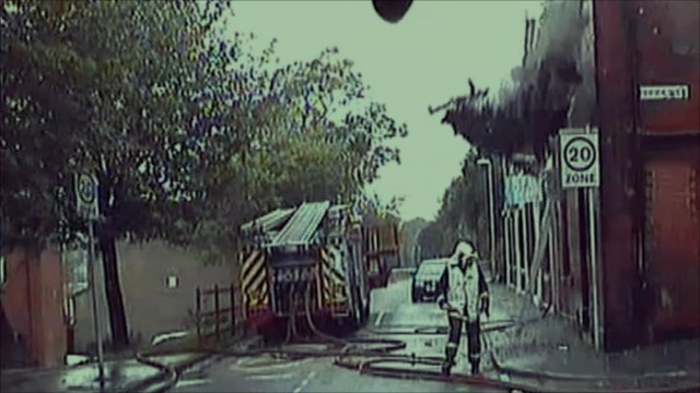 Wall collapsing behind firefighter