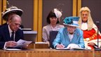 The Queen signs a document at the opening of the National Assembly for Wales in 2011