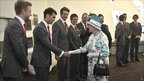 The Queen meets members of the choir Only Men Aloud in the Wales Millennium Centre