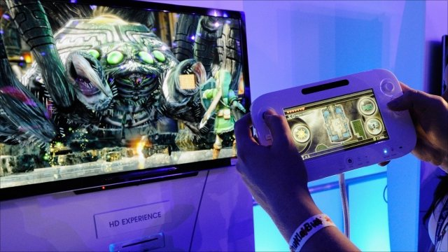 Wii U controller in front of HD TV while game is played at E3, Los Angeles