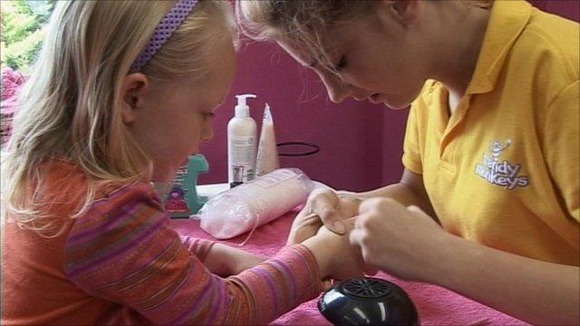 "Child having a ""mini manicure"""