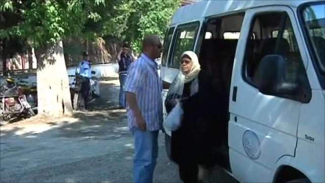 Refugees get off mini bus in Turkey