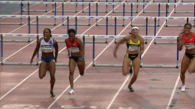 Danielle Carruthers wins the women's 100m hurdles