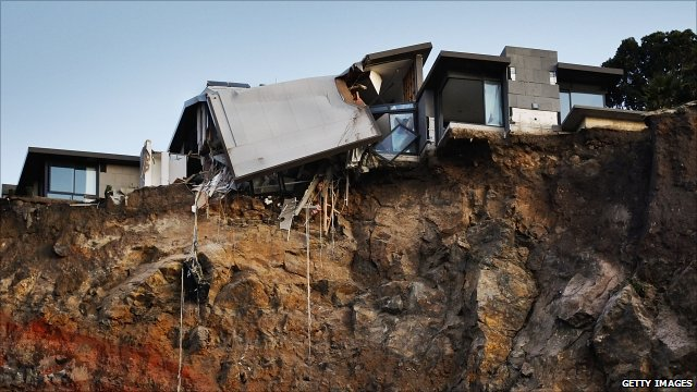 Remains of damaged house on a cliff which fell away during the quake