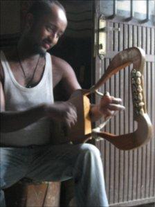 Man playing the krar