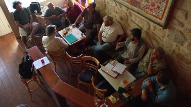 A group of people in a bar