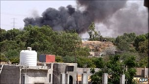 Smoke billows from Tripoli suburb after a Nato attack