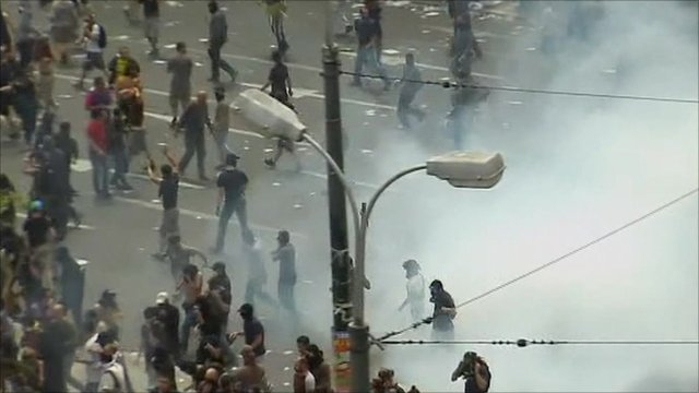 Demonstrators in a cloud of teargas