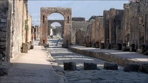 A street in Pompeii which, like Herculaneum, was covered by a volcanic eruption in 79AD