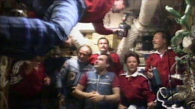 Astronauts and cosmonauts together after the shuttle docked with Mir