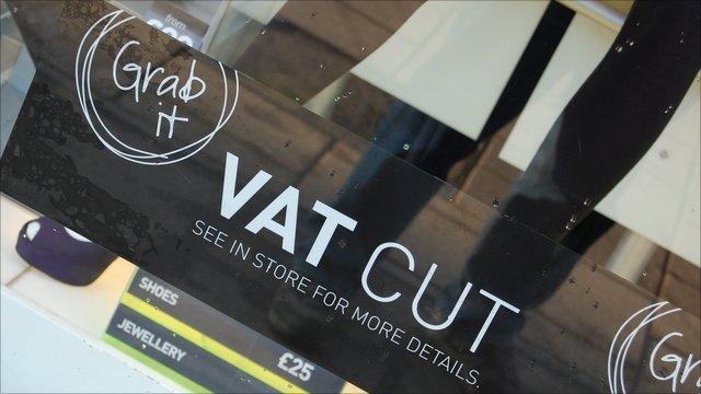 Shop window sign offering VAT cut