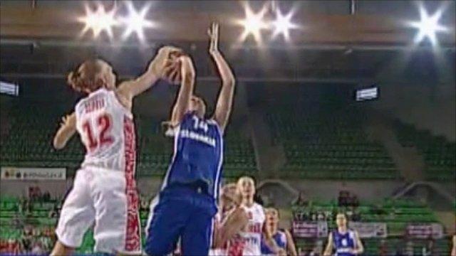 Russia's Irina Osipova blocks Slovakia's Romana Vynuchalova with seven seconds remaining