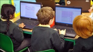 School children with laptops