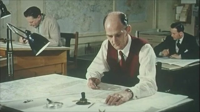 Archive pictures of men making maps