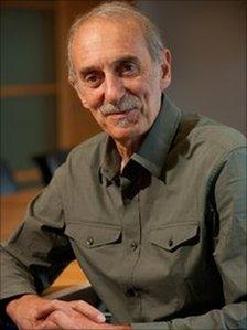 George Magnus in a green shirt