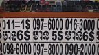 Mobile numbers on display at a stall