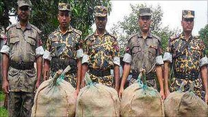 BGB guards with sacks containing the dried turtles