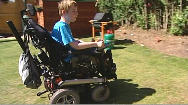 Declan Spencer, 12, on his specialised wheelchair