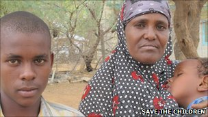 Somali mother and her two children in Kenyan refugee camp