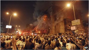 Firemen spray water into flames coming from Saint Mary Church, Cairo