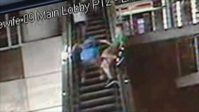 CCTV of teenager on an escalator
