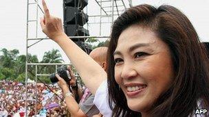 Yingluck Shinawatra, sister of fugitive former Thai prime minister Thaksin Shinawatra, waves to supporters 29 June 29