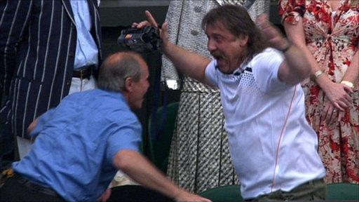 Members of Petra Kvitova's entourage celebrate her win in unusual fashion