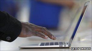 Hand typing on Macbook