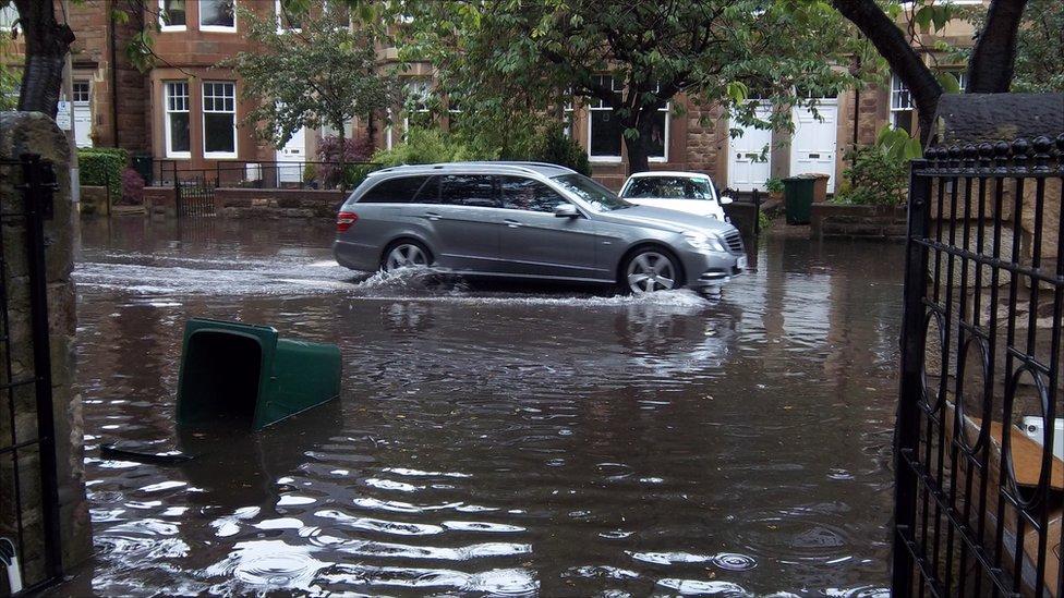 A car going through flood in Edinburgh