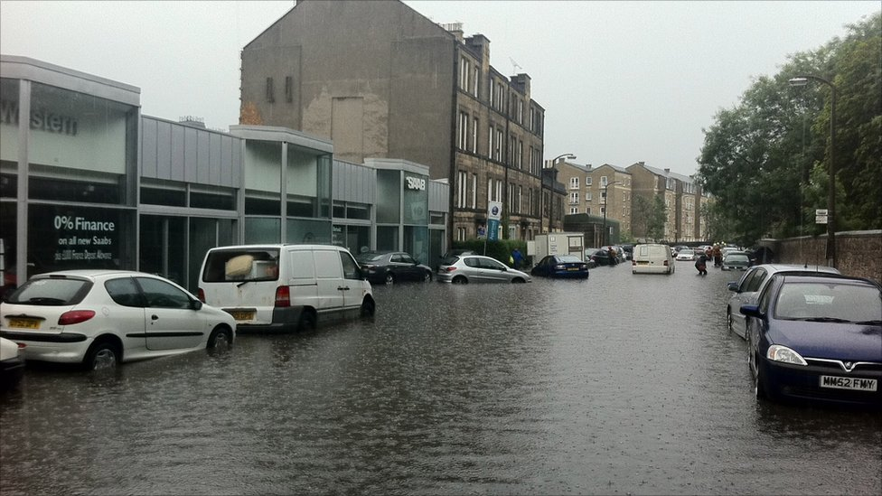Car in flood water outside Saab garage in Balcarres Street, Edinburgh