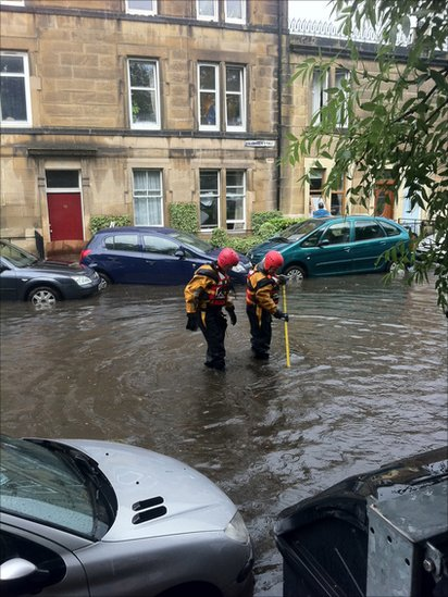The emergency services try to unblock drains after flooding in Edinburgh (Picture by James O'Brien)