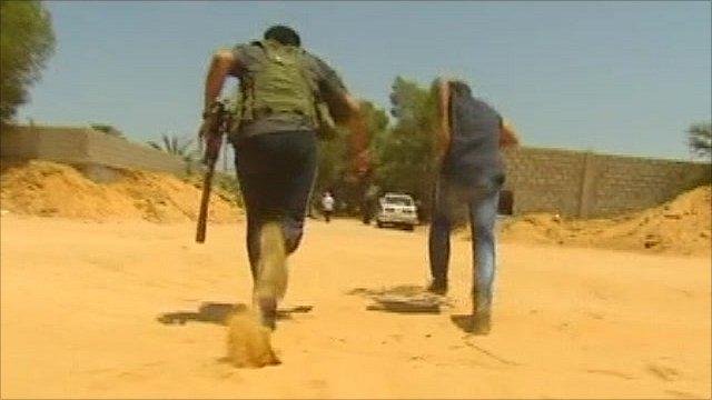 Libyan rebels running near front line