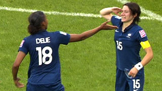 France's Elise Bussaglia celebrates equalising against England