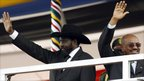 South Sudan's President Salva Kiir (L) and Sudan's President Omar al-Bashir wave to the crowd during the independence day ceremony in Juba, 9 July 2011
