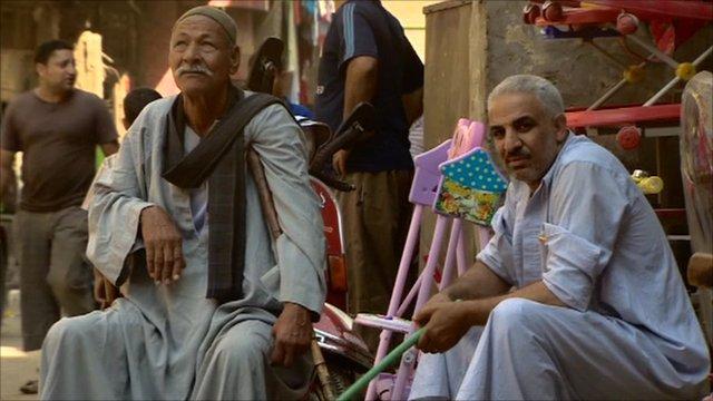 Men sitting in a street in Egypt