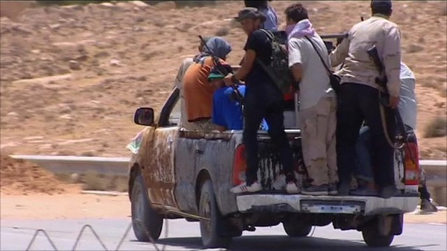 Libyan rebels retreating in the Nafusa mountains