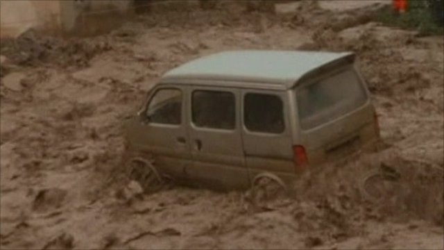 Vehicle swept away by flood water in China