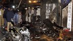 Police inspect the site of the bombing in the Zaveri Bazaar area of Mumbai