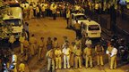 Indian police cordon off the scene of the bombing in the Dadar area of Mumbai