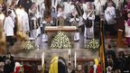 Austrian Cardinal Christoph Schoenborn (C) stands behind the coffin of Otto von Habsburg during the requiem mass at St Stephen's Cathedral in Vienna