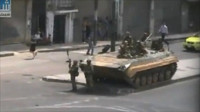 A photo sent in by a BBC News website reader of a tank on a street in Syria