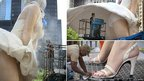 Workers put finishing touches on Forever Marilyn, a sculpture by Seward Johnson in Chicago, Illinois