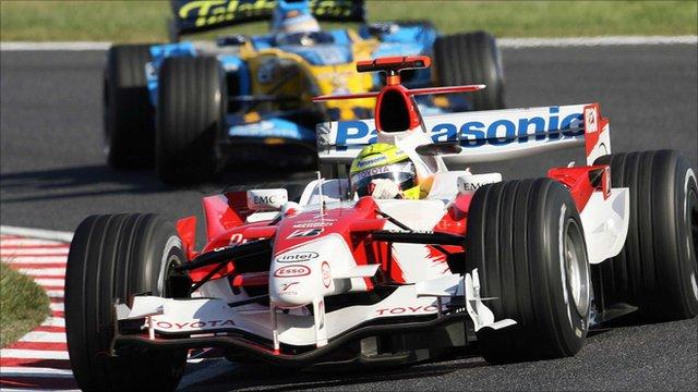 Toyota's Ralf Schumacher is pursued by Fernando Alonso