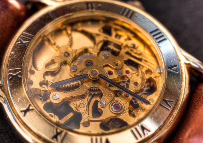A macro shot of a skeleton watch
