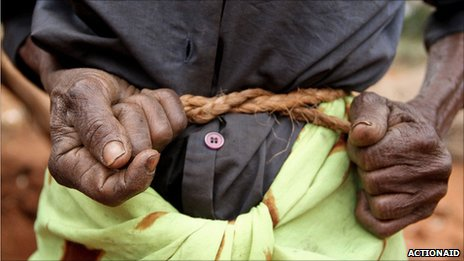 A woman binds her stomach to stave off hunger