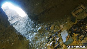 Unused ammunition lies on the ground in a cave previously used by al-Qaeda soldiers in the Tora Bora area of Afghanistan in December 2001