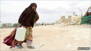 "A displaced Somali girl carries water at the Halabokhad IDP settlement in Galkayo, northwest of Somalia""s capital Mogadishu, 20 July 2011"